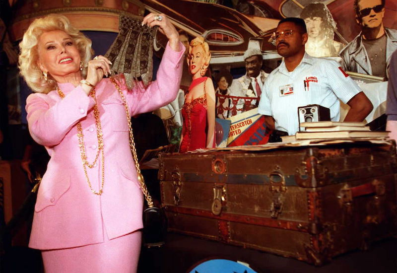 Actress Zsa Zsa Gabor,(L), holds up a beaded purse