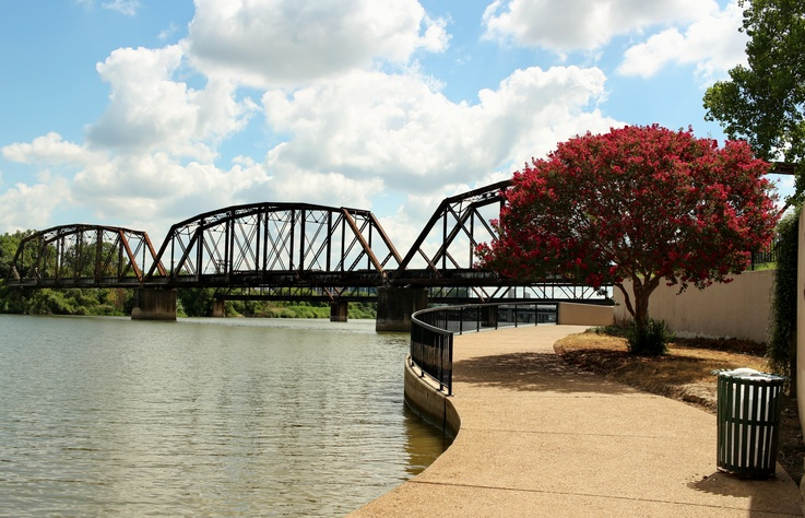 An old iron railroad bridge over the Brazos river near downtown Waco