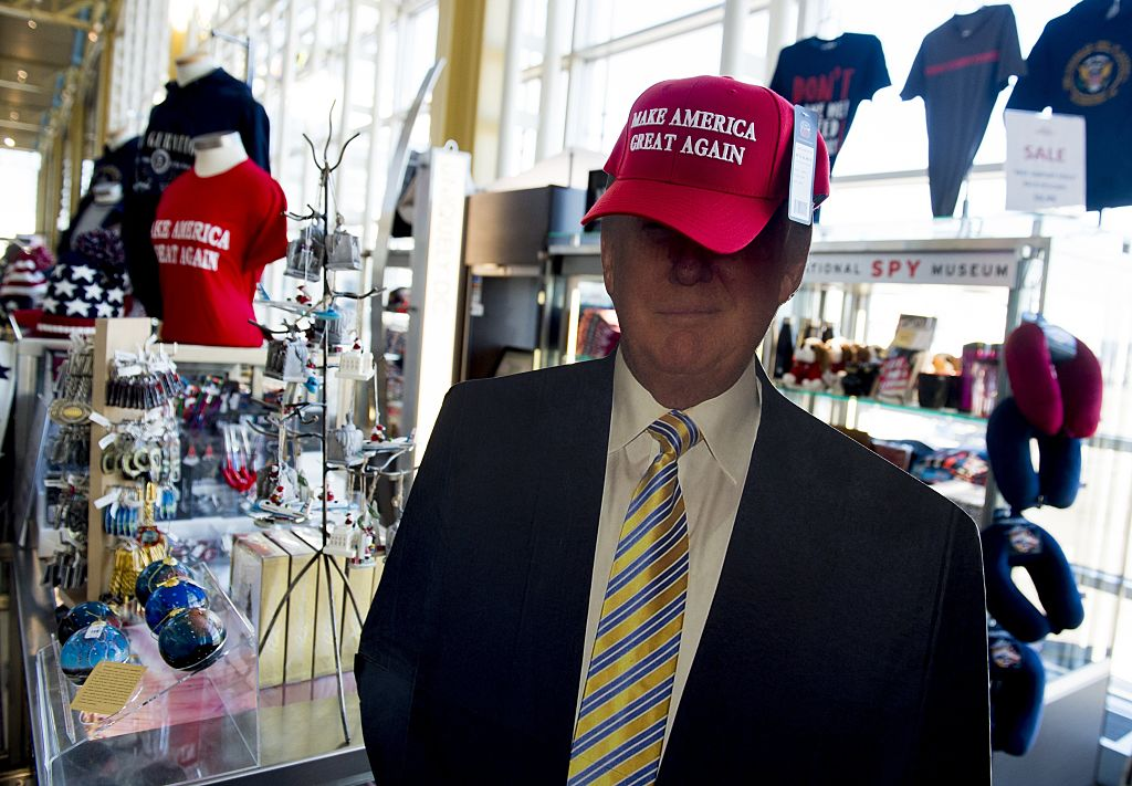 a donald trump cutout wearing a make america great again hat