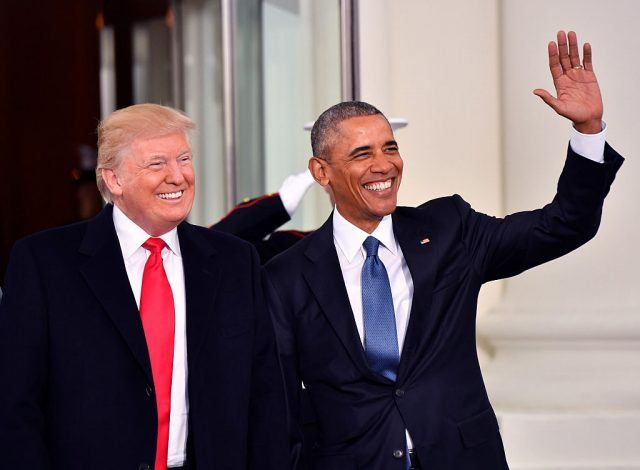 Donald Trump and Barack Obama smiling and waving.