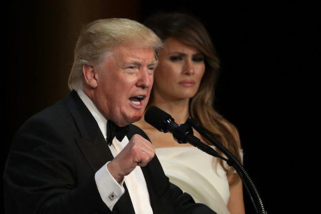 President Donald Trump speaks as his wife First Lady Melania Trump looks on during A Salute To Our Armed Services Inaugural Ball.