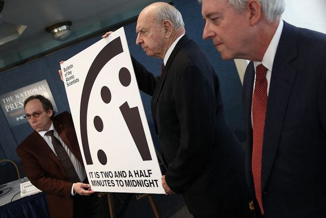 scientists display the atomic clock at two minutes and thirty seconds to midnight.