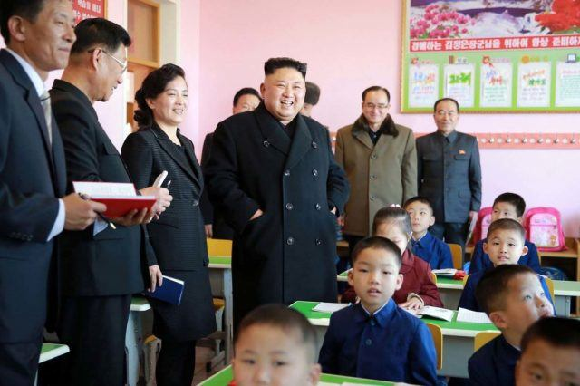 North Korean leader Kim Jong-Un visiting a school.