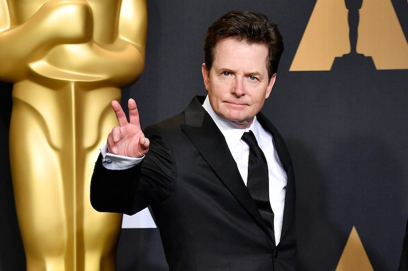 Actor Michael J. Fox poses in the press room