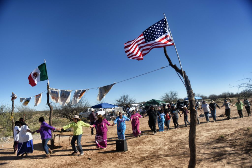 Indigenous people from the Tohono O'odham ethnic group dance and sing to protest