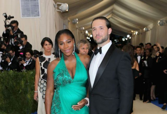 Serena Williams and Alexis Ohanian posing on a red carpet.