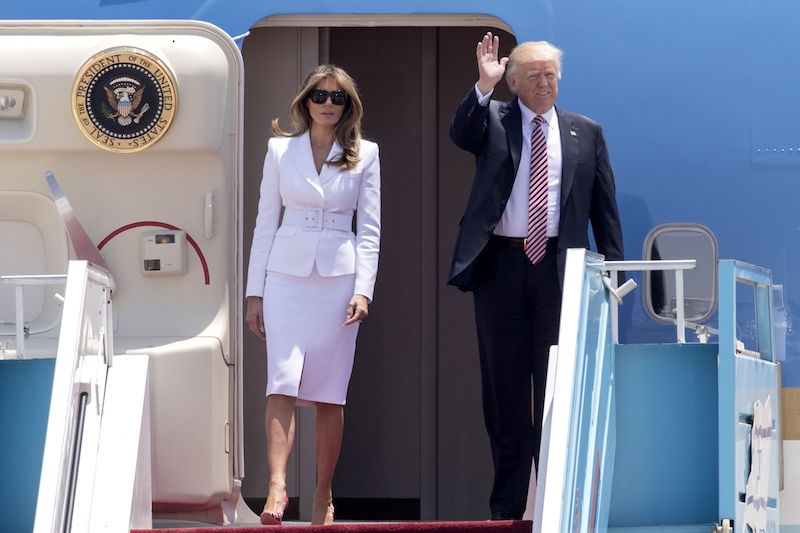 US President Donald Trump and First Lady Melania Trump disembark Air Force One