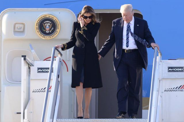 Melania Trump and Donald Trump departing from a plane.