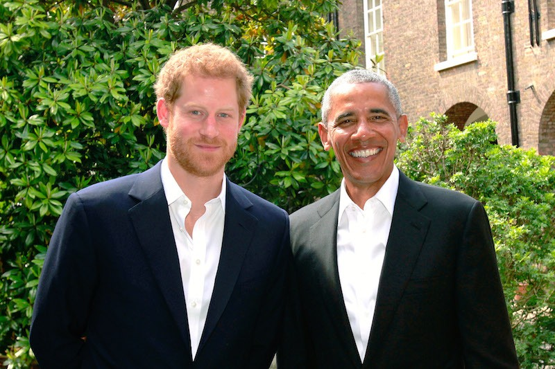 Prince Harry (left) poses with former US President Barack Obama