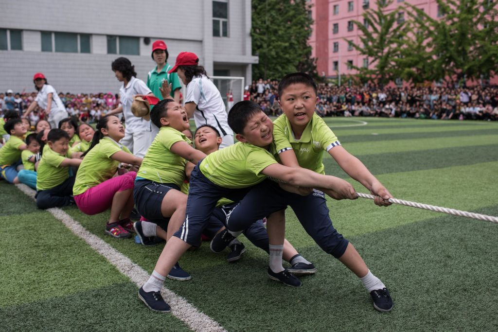 School children take part in a tug-of-war during sports games marking 'Children's Union Foundation day', in Pyongyang.