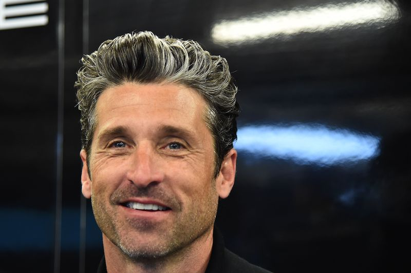 US actor Patrick Dempsey smiles in the pit of Porsche