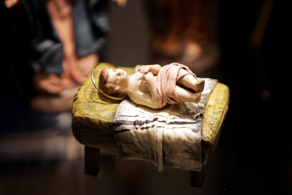 a sculpture of the baby jesus in a nativity set