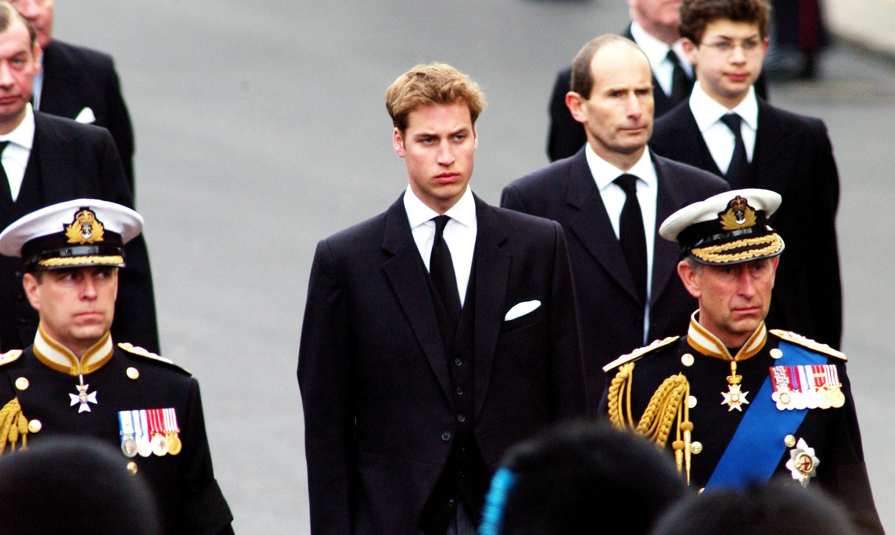 Britain's Prince Charles (R) Prince Andrew (L) and Prince William (C) walk behind the Gun Carriage bearing the coffin of the Queen Mother April 9, 2002 as it makes its way to Westminster Abbey during her state funeral April 9, 2002 in London.