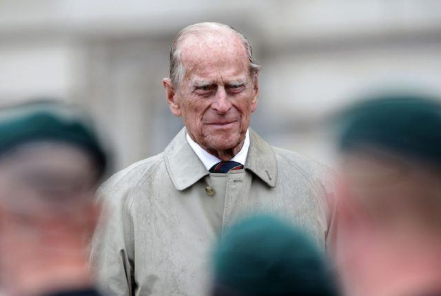 Prince Philip wearing a beige coat.