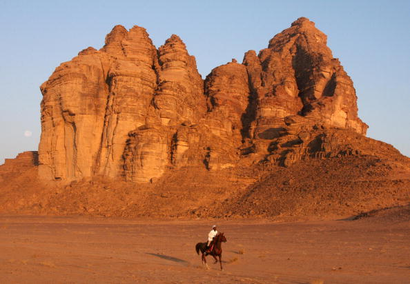 a jockey and his horse in wadi rum