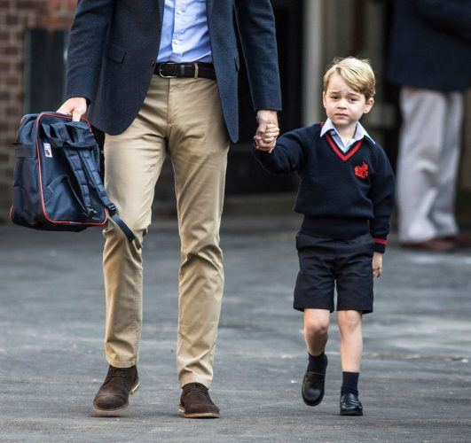 Prince George of Cambridge arrives for his first day of school with his father Prince William, Duke of Cambridge.