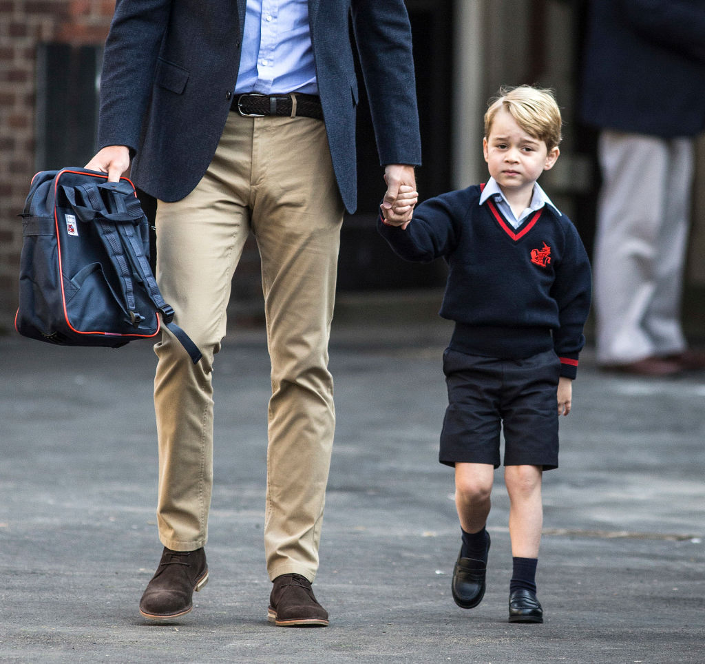 Prince George of Cambridge arrives for his first day of school with his father Prince William, Duke of Cambridge at Thomas's Battersea on September 7, 2017 in London, England.