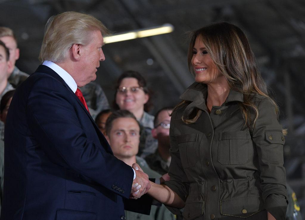 Donald Trump and Melania Trump shake hands