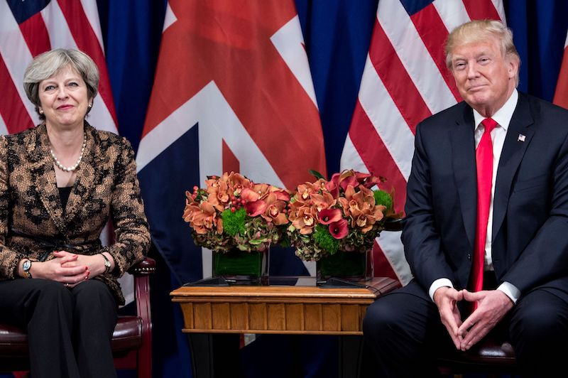 British Prime Minister Theresa May and US President Donald Trump wait for a meetin