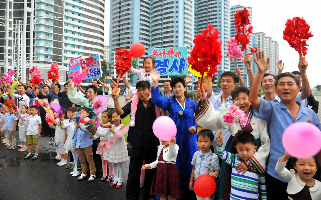 This September 6, 2017 picture released from North Korea's official Korean Central News Agency (KCNA) on September 7, 2017 shows Pyongyang residents greeting arrival of contributors to the test of a hydrogen bomb for ICBM in Pyongyang.