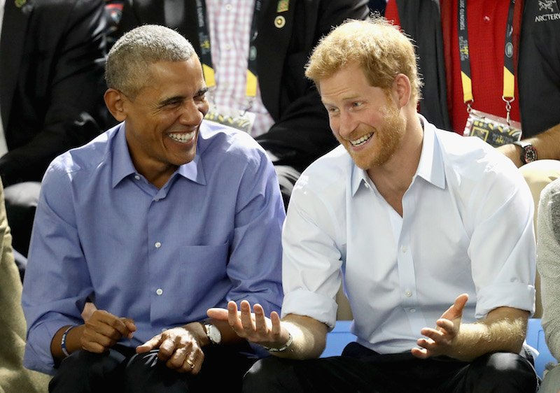 Former U.S. President Barack Obama and Prince Harry share a joke as they watch wheelchair baskeball