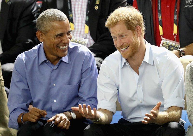 Former U.S. President Barack Obama and Prince Harry share a joke as they watch wheelchair baskeball