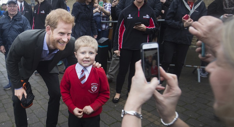 Prince Harry poses with a child as he visits the Sir Tom Finney Soccer Development Centre and the Lancashire Bombers Wheelchair Basketball Club at the University of Central Lancashire (UCLan) sports arena on October 23, 2017 in Preston, England. (Photo by Danny Lawson - WPA Pool/Getty Images)