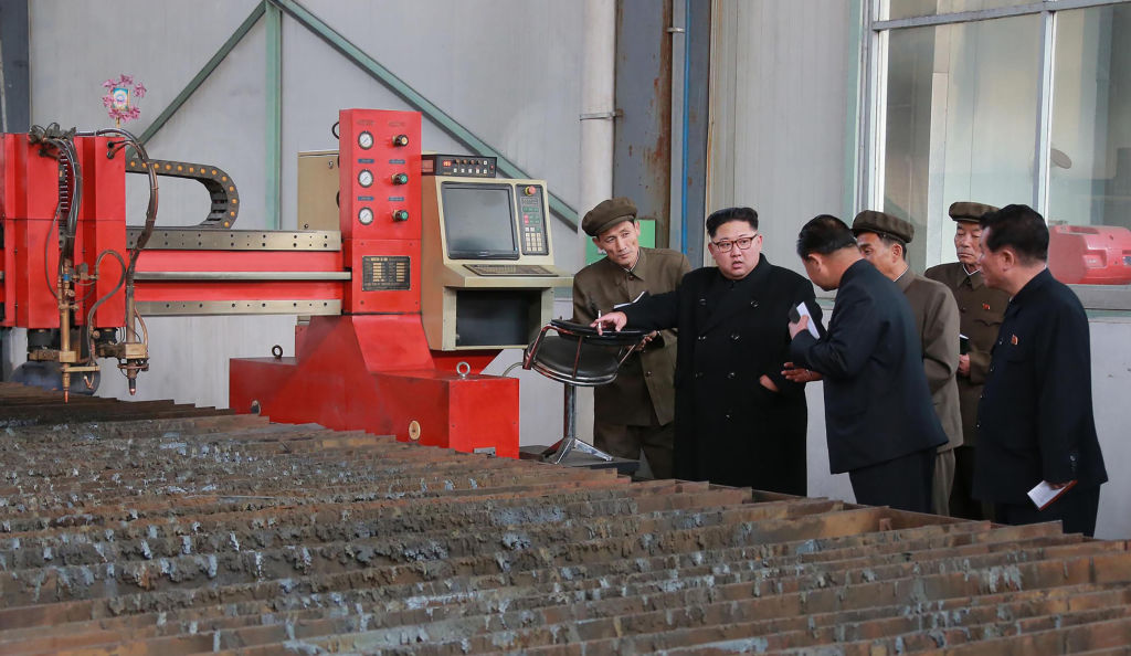 North Korean leader Kim Jong Un visits a factory at an undisclosed place.