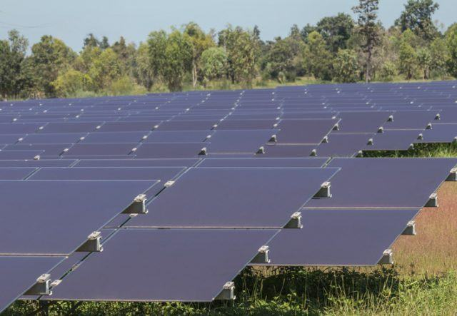 Array of thin film solar cells or amorphous silicon solar cells in solar power plant turn up skyward absorb the sunlight from the sun use light energy to generate electricity alternative renewable energy from the sun