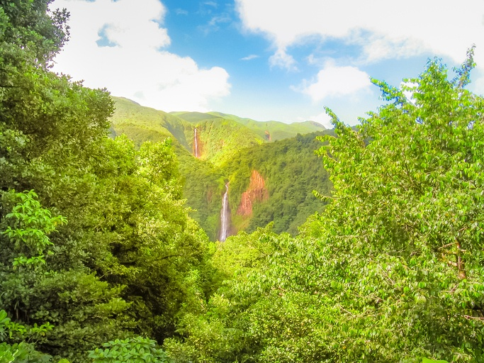 Scenic landscape in tropical rainforest of Carbet Falls or Les Chutes du Carbet, on Carbet River, Guadeloupe island, Caribbean, French Antilles