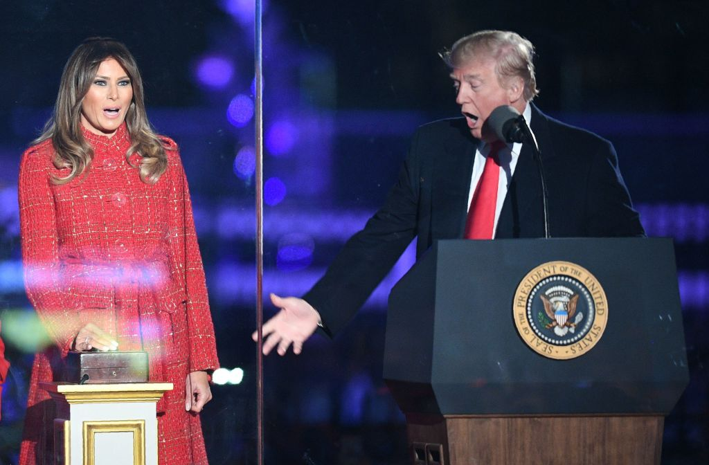 trump gesturing at melania during the christmas tree lighting