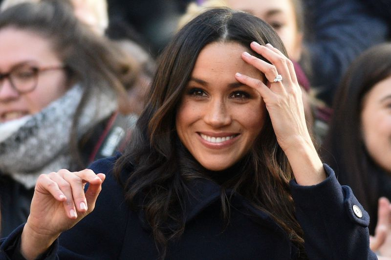 Britain's Prince Harry's fiancee US actress Meghan Markle displays her engagement ring as she greets wellwishers on a walkabout as they arrive for an engagement at Nottingham Contemporary in Nottingham, central England, on December 1, 2017 which is hosting a Terrence Higgins Trust World AIDS Day charity fair.<br />