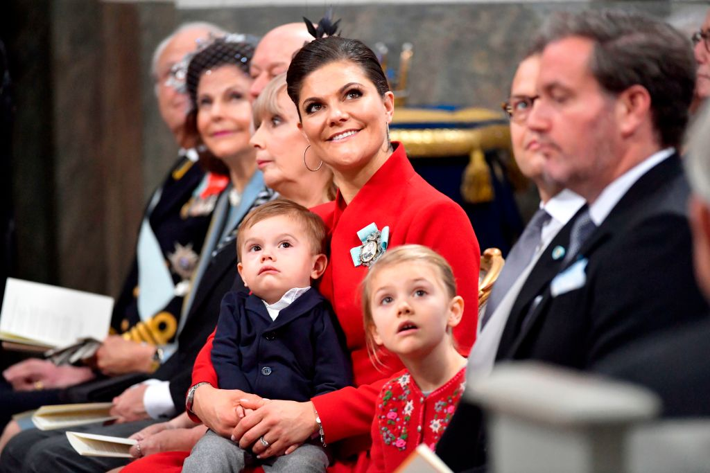 (L-R) King Carl Gustaf of Sweden, Queen Silvia, Erik Hellqvist, Marie Hellqvist, Crown princess Victoria with Prince Oscar, Prince Daniel and Mr Christopher O'Neill