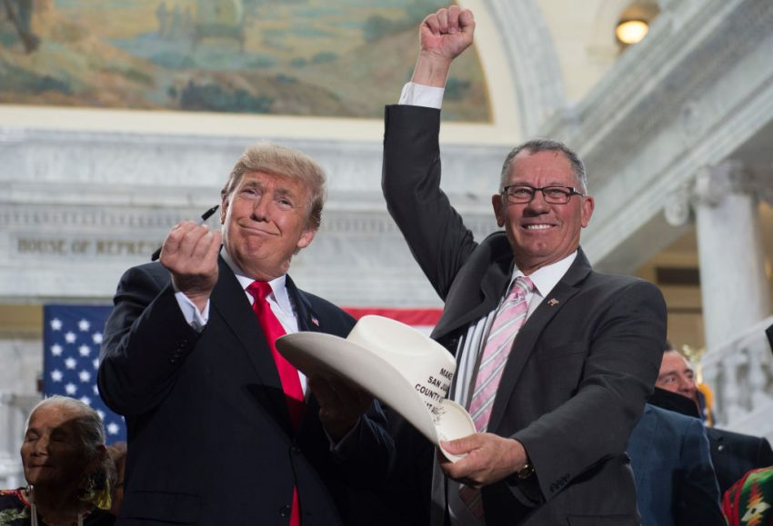 Trump being a douchebag with a pen, a cowboy hat, and a puppet