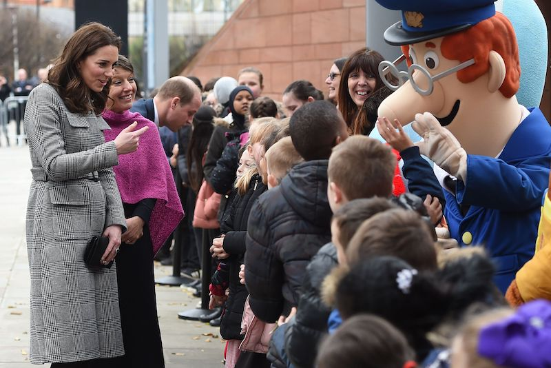 Britain's Catherine, Duchess of Cambridge and her husband Britain's Prince William, Duke of Cambridge meet children as they arrive to attend the Children's Global Media Summi