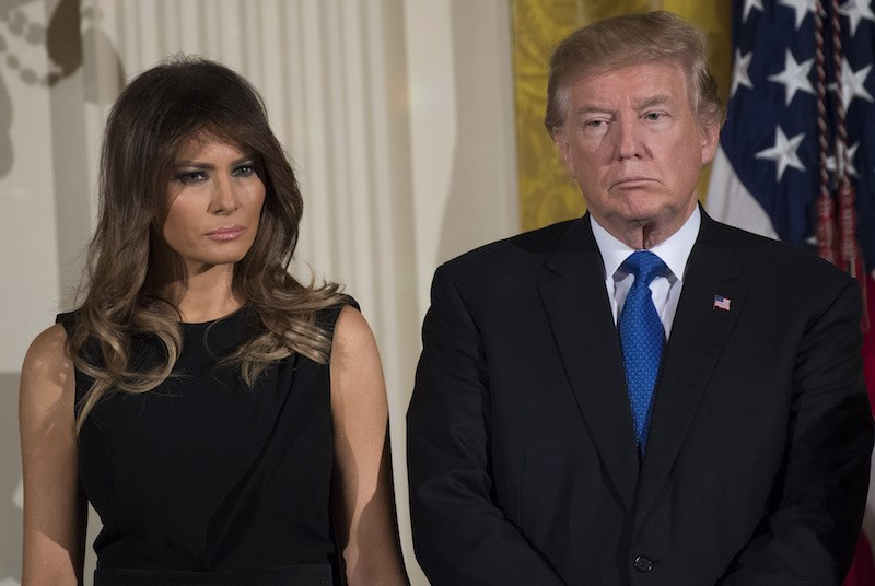 US President Donald Trump and First Lady Melania Trump attend a Hanukkah reception in the East Room of the White House in Washington, DC, December 7, 2017. / AFP PHOTO / SAUL LOEB (Photo credit should read SAUL LOEB/AFP/Getty Images)