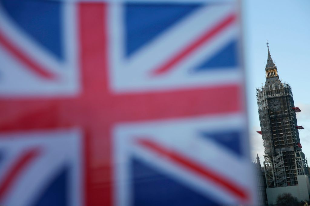 A Union Flag is seen with Elizabeth Tower (Big Ben)