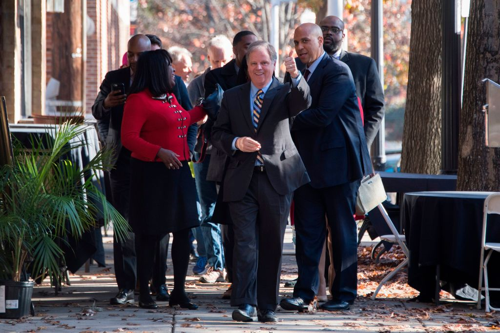 doug jones walks with other canvassers before the election