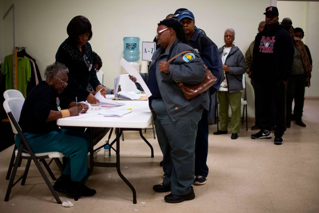 people wait in line to vote in alabama