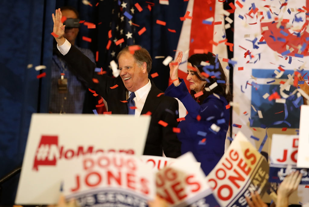 doug jones and his wife celebrate with confetti