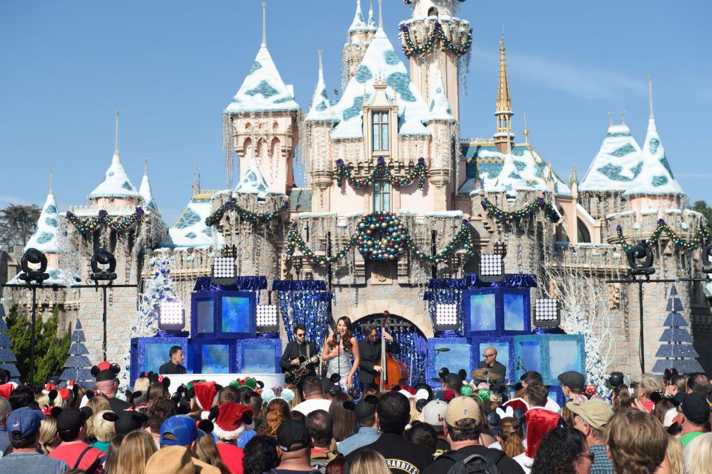 "Lea Michele performs the holiday favorite ""Let It Snow"" from Sleeping Beauty Castle at Disneyland."