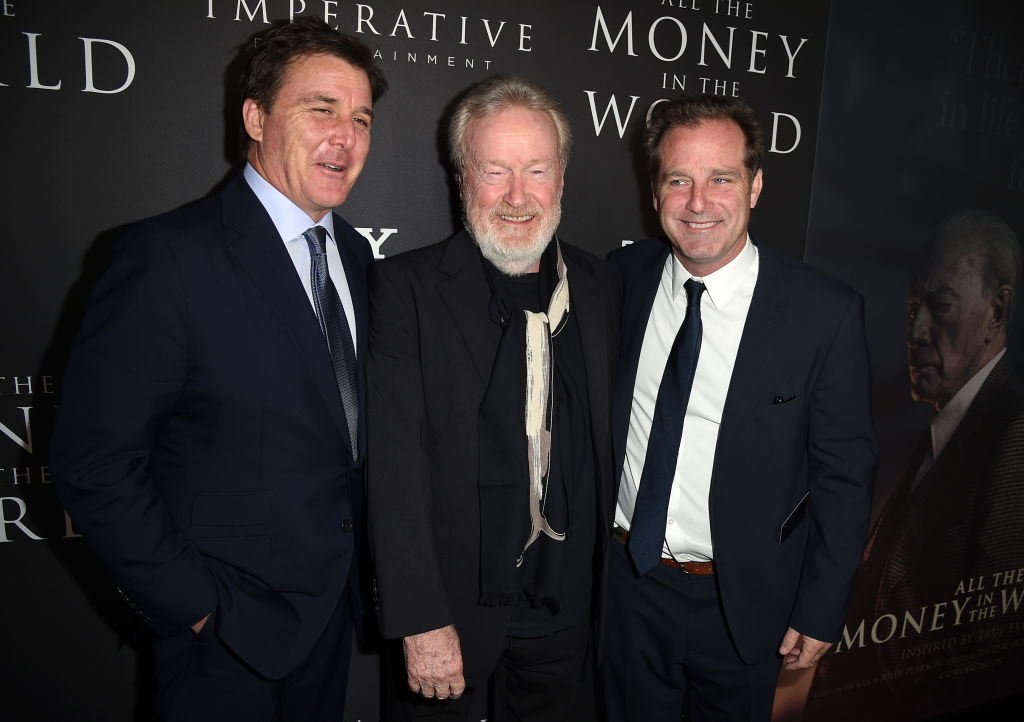 "Ridley Scott (center) with producers Dan Friedkin (left) and Bradley Thomas (right) at the premiere of All The Money In The World"" on December 18, 2017."
