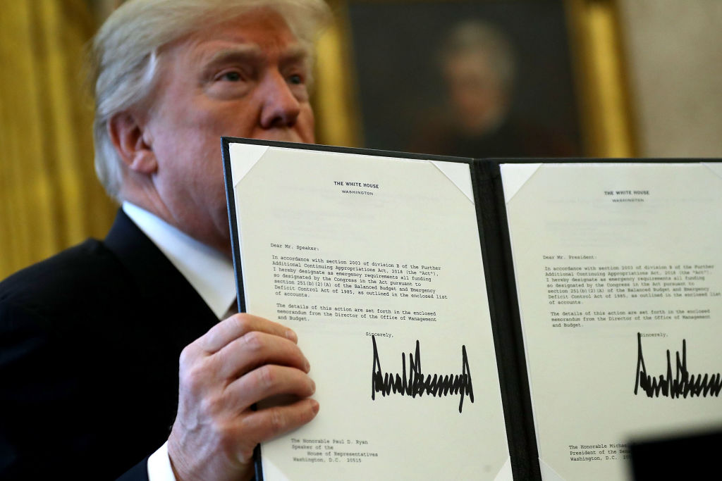 Donald Trump signs tax reform bill