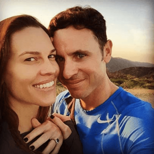 Hilary Swank and her fiancé posing with her engagement ring.