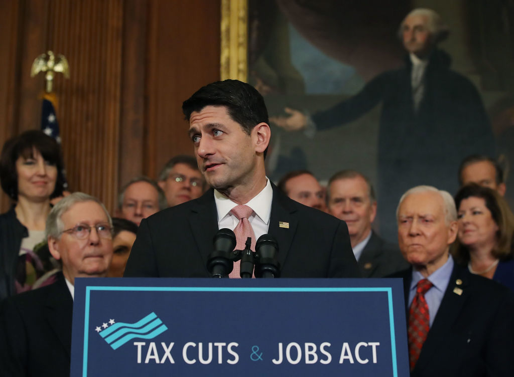 U.S. House Speaker Paul Ryan speaks during an enrollment ceremony for the conference report