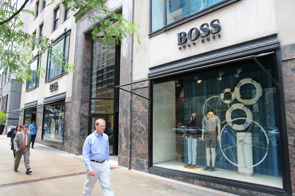 eople walk past Hugo Boss store at Magnificent Mile