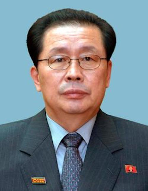 Jang Song Thaek in front of a blue background.
