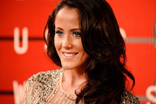 Jenelle Evans smiles while posing in a gold gown.