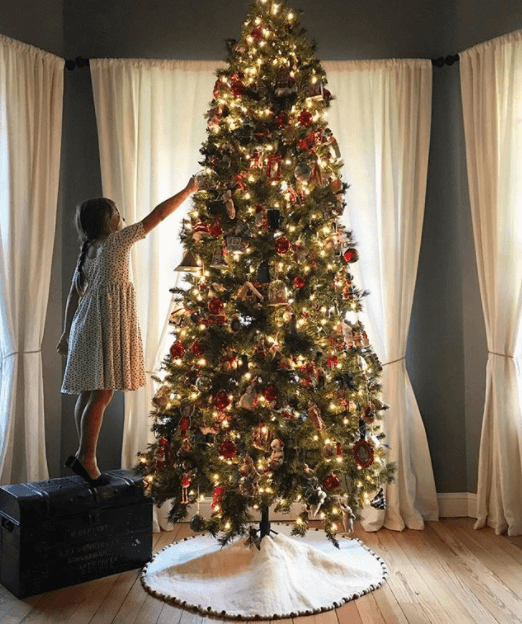 Gaines' daughter decorating the Christmas tree