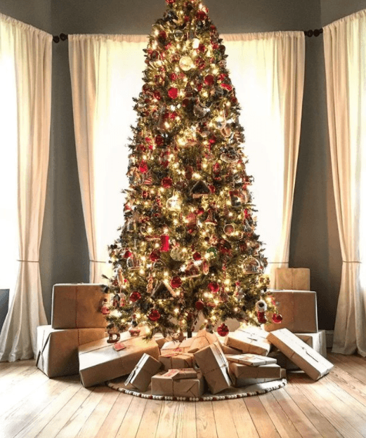 The Gaines family christmas tree surrounded by presents